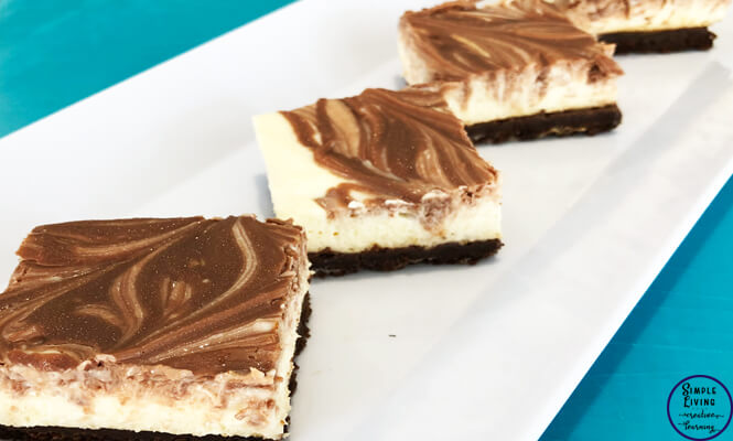This Chocolate Cheesecake Slice is has a chocolate biscuit base, easy cheesecake middle with melted chocolate sprinkled on the top and spread through. Delicious!
