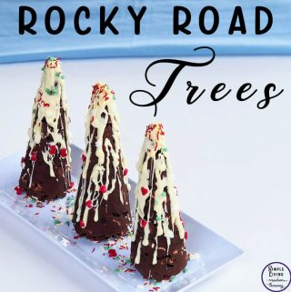 These gorgeous Rocky Road Christmas Trees are a great, edible centrepiece and dessert for your Christmas meal this year. They could also be given as gifts.